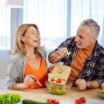 Happy Couple Cooking Healthy in Kitchen