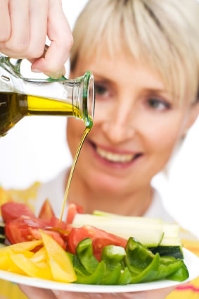 Olive oil on a salad can is not a diet food.